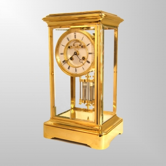 French 4-glass mantel clock with visible escapement and mercurial pendulum for sale. Circa 1870.