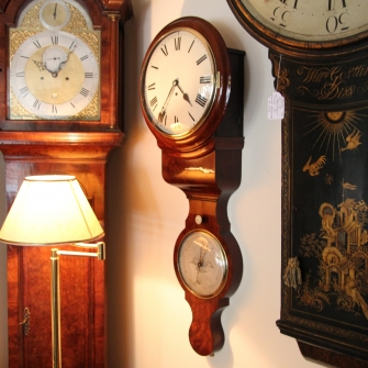 Rare English fusee wall clock incorporating a mercurial barometer.