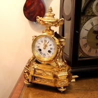 Small antique French ormolu striking mantel clock for sale.