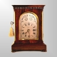 Small chain fusee rosewood Library clock by Delasalle and Christie of London. Circa 1835.