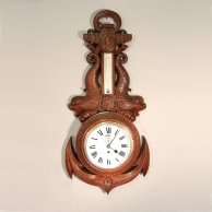 Ship's clock in a carved oak case in the form of an anchor with reference to Nelson.