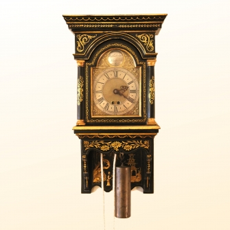 Small hooded wall clock by William Risbridger of Dorking.