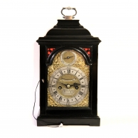 Miniature verge bracket or table clock in an ebonised case. Quarter repeating, made by Anthony Harri
