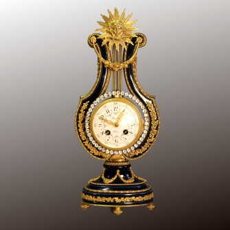 Blue porcelain and ormolu French Lyre clock. Striking on a bell and having a crystal pendulum.