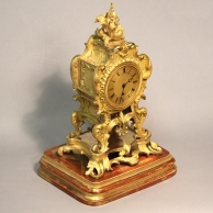 Regency fusee English mantel clock. Rococo style ormolu case. By John Peterkin, London. C.1820.