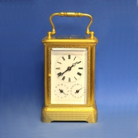 Rare, repeating French engraved carriage clock with alarum, calendar work and double striking. Circa