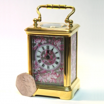 Miniature Porcelain panel French carriage clock By Richard of Paris.