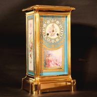 French 4-glass style mantel clock in an ormolu case with blue porcelain panels. Circa 1870.
