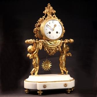 Antique French mantel clock in an ormolu case.