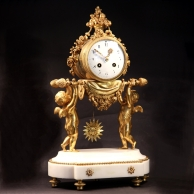 Antique French mantel clock in an ormolu case.