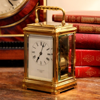 FRENCH REPEATING CARRIAGE CLOCK IN A GORGE CASE. RETAILED BY BARRAUD AND LUNDS. Circa 1890.