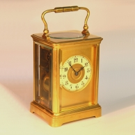 A modest antique striking French carriage clock for sale.