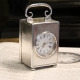 Miniature silver carriage clock in an engine turned case. Hallmarked 1899.