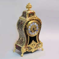 Boulle cased French striking mantel clock with red tortoishell and ormolu mounts. Circa 1890.