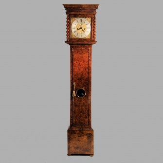 Early English longcase clock in a walnut case with Burr elm front. Made by John Barnett circa 1695.