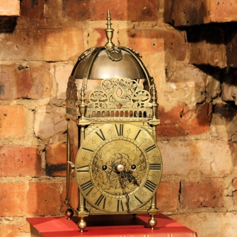 Lantern clock by Edward Norris of London.