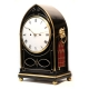 Lancet top, Regency fusee bracket clock in a brass-strung ebonised case. English, Circa 1815.