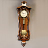 Miniature vienna regulator wall timepiece in a serpentine walnut case. circa 1870.