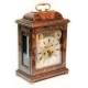 A fine William III table clock by Edward Burgis of London. in a walnut oyster case. Circa 1695.