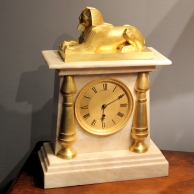 English, Egyptian style, fusee mantel clock. Circa 1850.