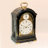 Georgian triple pad-top bracket clock with a rare enamel and brass dial. Circa 1785.