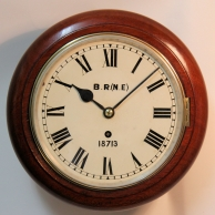 British Railways fusee dial clock. Mahogany case and eight inch diameter dial circa 1920.
