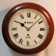 British Railways fusee dial clock. Mahogany case and eight inch diameter dial circa 1920.