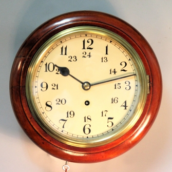 24 hour, English fusee wall clock with an 8 inch dial and mahogany case. circa 1900.