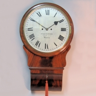 Striking, double fusee English drop-dial wall clock in a mahogany case. Circa 1840.