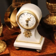 Very small French mantel clock in a white marble and ormolu balloon shaped case. Circa 1900.
