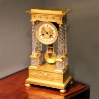 French Portico, four pillar mantel clock in ormolu and cut crystal case. Circa 1830.