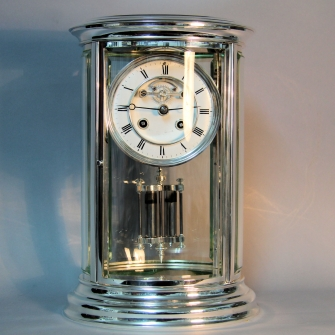 FRENCH, FOUR GLASS, silver plated, OVAL MANTEL CLOCK WITH VISIBLE ESCAPEMENT. CIRCA 1875.