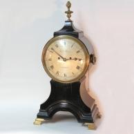 Georgian 'Balloon' table clock in an ebonised case. Circa 1790.