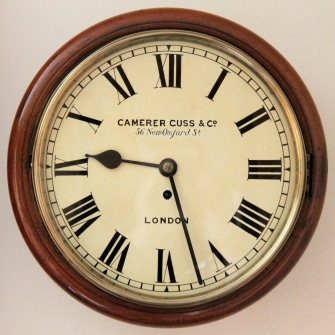 English fusee dial wall clock retailed by camerer Cuss, London. Circa 1890.