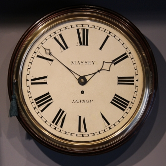 Early English dial clock with transitional features. Made by Massey of London. Circa 1810.