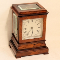 Small English 5-glass fusee library timepiece in a rosewood case. Circa 1845.