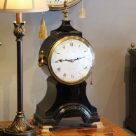 Georgian 'Balloon' table clock in an ebonised case. Circa 1790.