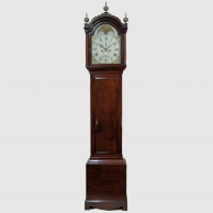 Eight day longcase clock in a plain oak case. Made by B. Russell of Norwich. Circa 1810.