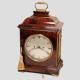 19th century mahogany table clock by Thwaites & Reed, London. Having a John Ellicott style round