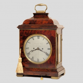 19th century mahogany table clock by Thwaites & Reed, London. Having a John Ellicott style round