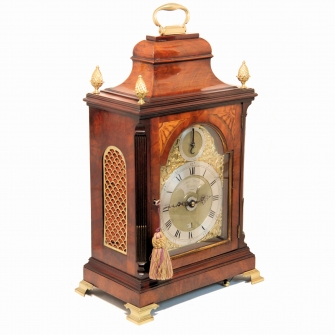 A Georgian mahogany table clock with Verge escapement, fan inlay and Alarum.