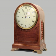 Regency arched striking bracket clock by Brockbanks. In a mahogany case circa 1810.