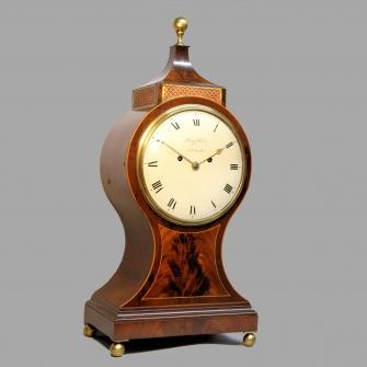 A Georgian Balloon style, mahogany table clock made by Henry Harris of London. Circa 1800.