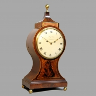 A Georgian Balloon style, mahogany table clock made by Henry Harris of London. Circa 1800.