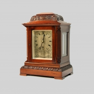 A Small English, four glass Library table clock by Brockbanks & Atkins, London.