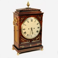A good Regency, gadrooned chamfer top bracket clock in an elaborate mahogany case. Circa 1815.