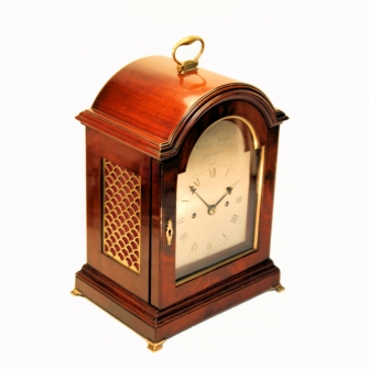 Small bracket or table clock by Perigal of London. Having a mahogany case and silvered dial. Circa 1