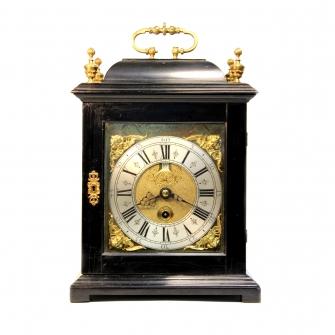 An early English, ebony table clock by Jasper Tayler