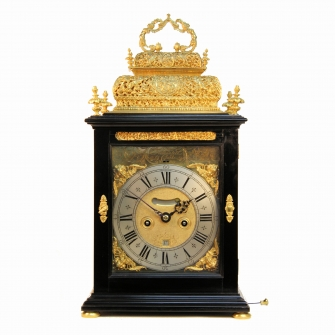 A fine example of a double basket top, table clock by Fromanteel & Clarke, Amsterdam. Circa 1700
