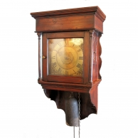 George III hooded wall clock in it's original stained pine case. Circa 1760.
